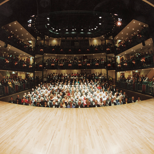 A photograph taken on stage of a full audience on the opening night of the theatre in 1994.